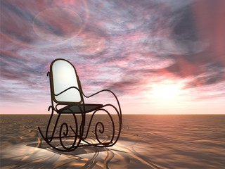 Conceptual armchair standing in dessert at sunset