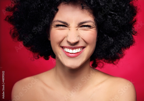 Woman with black afro hairstyle smiling