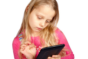 little girl using ebook reader