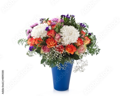 Fresh flowers in a blue vase