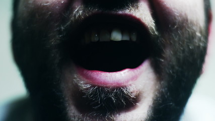 Freaky bearded man opening his mouth in slow motion