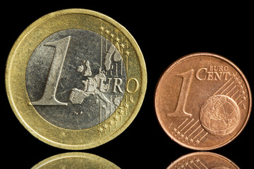 Two used coin - one euro and one eurocent