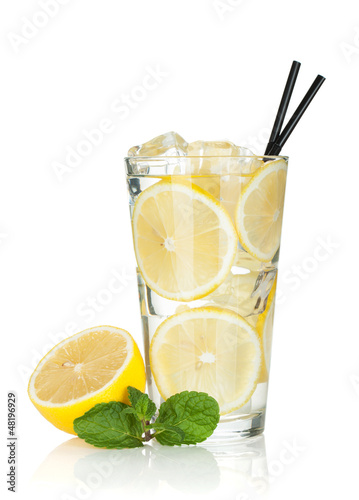 Glass of lemonade with lemon and mint