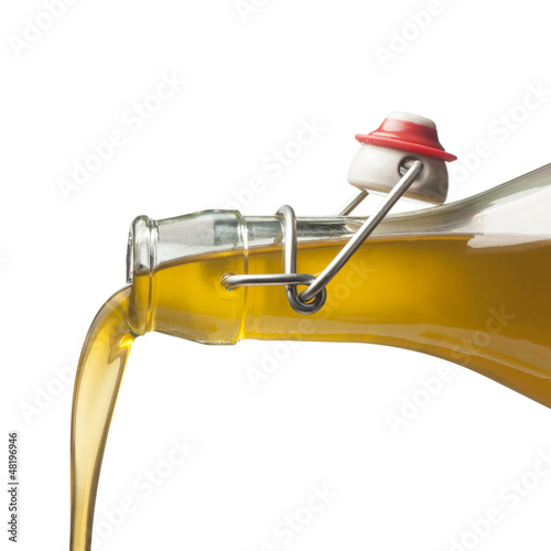 Pouring olive oil with a bottle