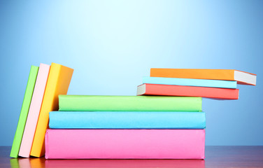 Stack of multicolor books   on blue background