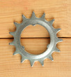 Metal cogwheel on wooden background