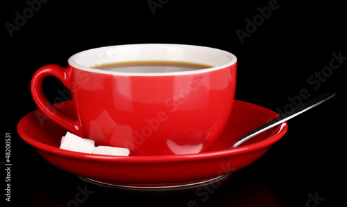 A red cup of strong coffee isolated on black