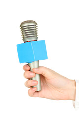 Female hand with microphone isolated on white