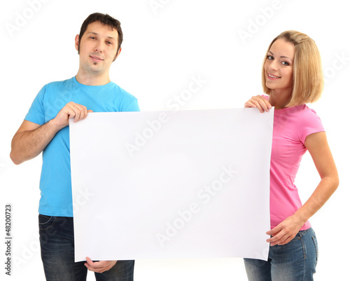 Young couple holding blank poster isolated on white