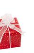 Rotes Geschenk mit weißer Schleife