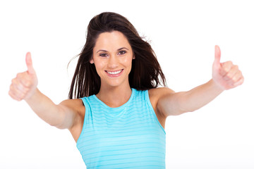 cheerful young woman giving two thumbs up on white background