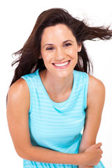 happy young woman laughing over white background