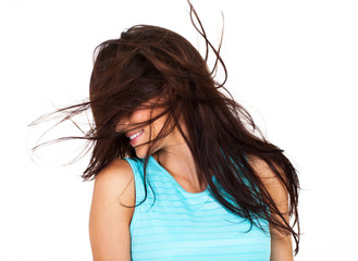 young woman having fun with messy hair isolated on white