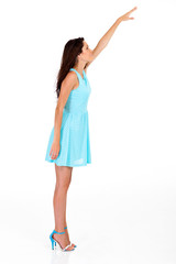 tall young woman reaching for something high