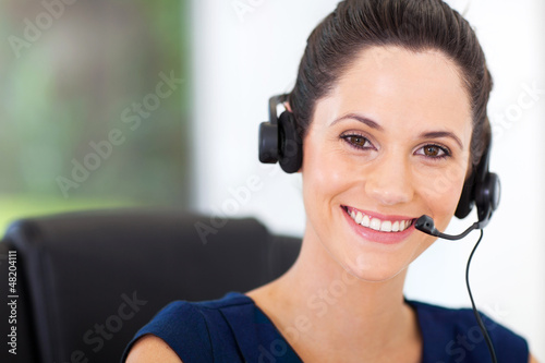 cute young business call center operator with headphones