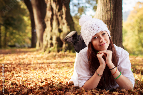 Beautiful Teenager Girl in park during autumn. Caucasian Beauty.