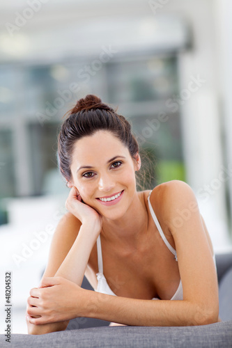 attractive young woman relaxing on sofa at home