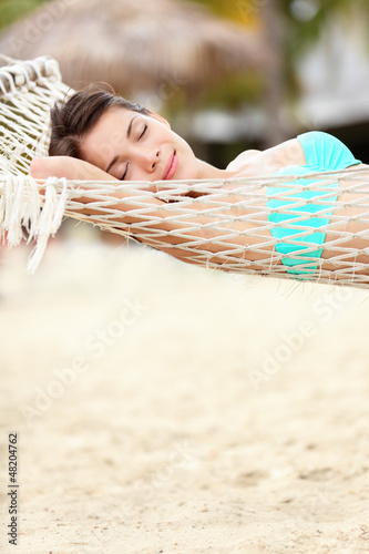 Beach lifestyle woman in hammock