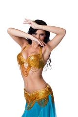 Belly dancer wearing a gold and blue costume