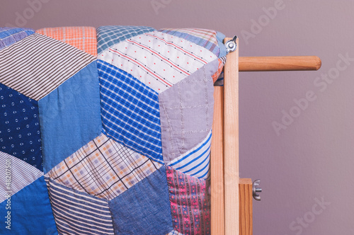 Detail View Of Antique Quilt On Wooden Stand - 48207501