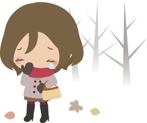 泣きながら冬の道を歩く若い女性