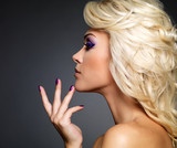 Fototapety Beautiful woman with beauty purple manicure and makeup of eyes.