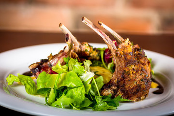 lamb chops with mashed potatoes and a little salad.