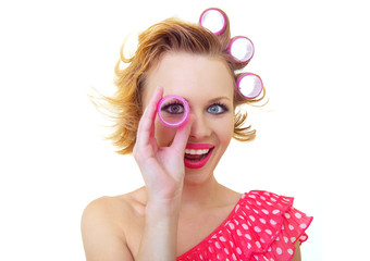 Funny woman with hair style looking thro curlers