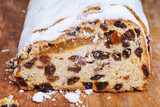 sliced Stollen cake with dried fruit and marzipan