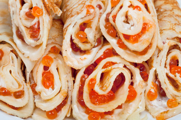 pancakes rolls with red caviar close up