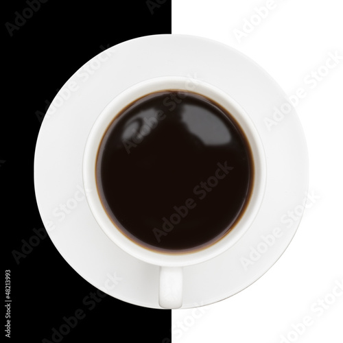 Highly stylised image of coffee cup and saucer on black and whit