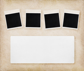 Empty instant photos on old paper texture