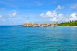 row of water bungalows on maldives with view over ocean