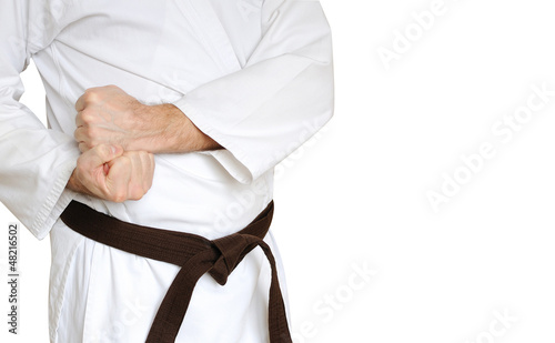 Man in a kimono and belt for martial arts on the white backgroun