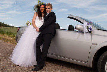 groom and bride on a background cabriolet