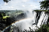 Fototapety Rainbow over Victoria Falls on Zambezi River