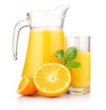 Jug, glass of orange juice and orange fruits with green leaves i