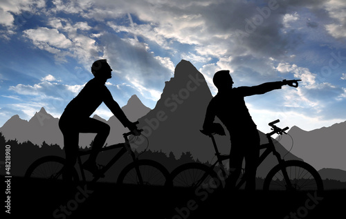 silhouette  cyclists  in sunset