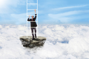 Businessman climbs stairs above clouds