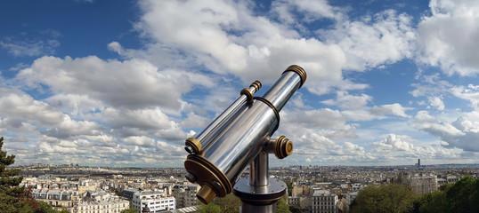 Telescope viewer and Paris skyline