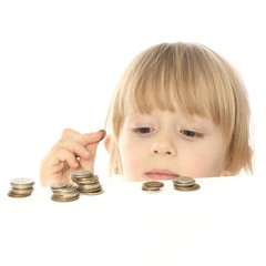 portrait of a beautiful little girl who finds the coin