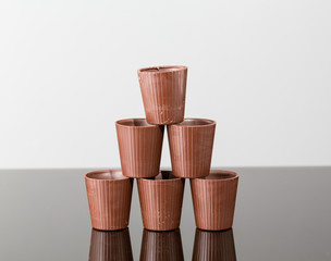 Stack of chocolate cups