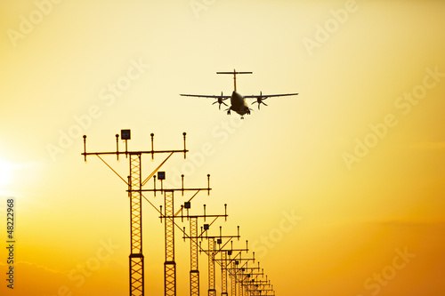 Propeller airplane is landing