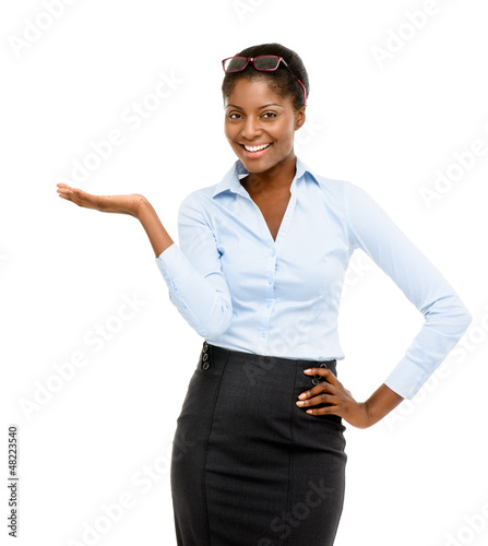 Happy African American businesswoman showing empty copy space is