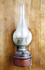 old kerosene lamp on wooden wall
