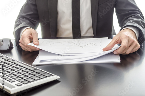 Businessman analyzing diagram