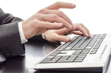 Male hands typing on keyboard