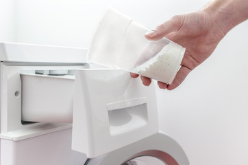 Pouring detergent into the washing machine