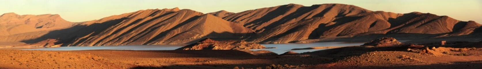 Panoramic of Sand dunes over an Oasis in Morocco