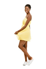 Beautiful African American Woman dancing yellow dress isolated o